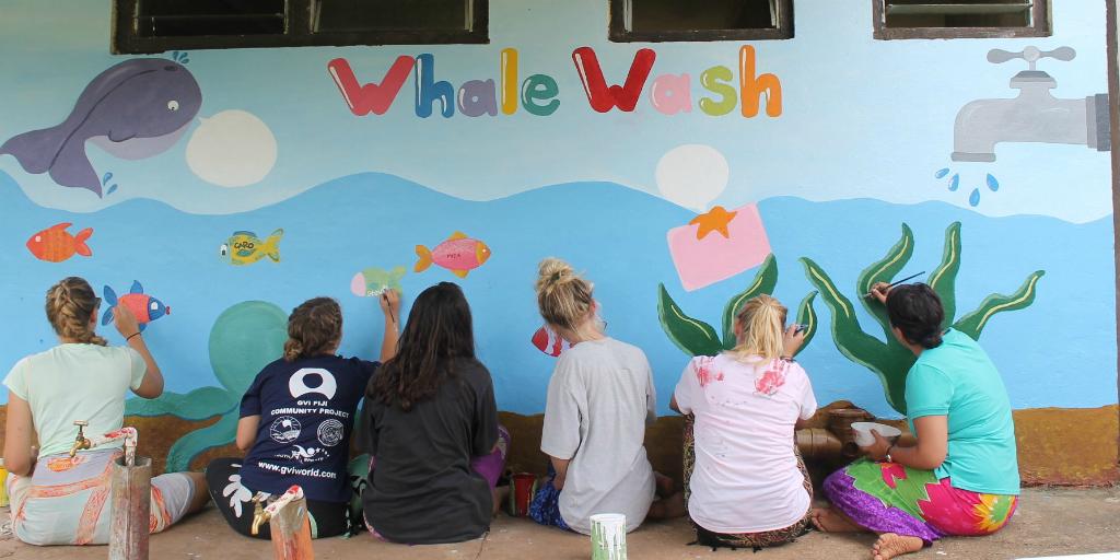 volunteers brightening up walls in Fiji