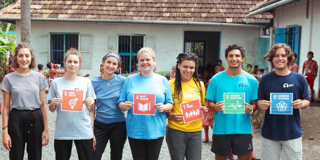 GVI volunteers demonstrate which of the United Nations Sustainable Development Goals (UN SDGs) they are working toward in Kerala, India.