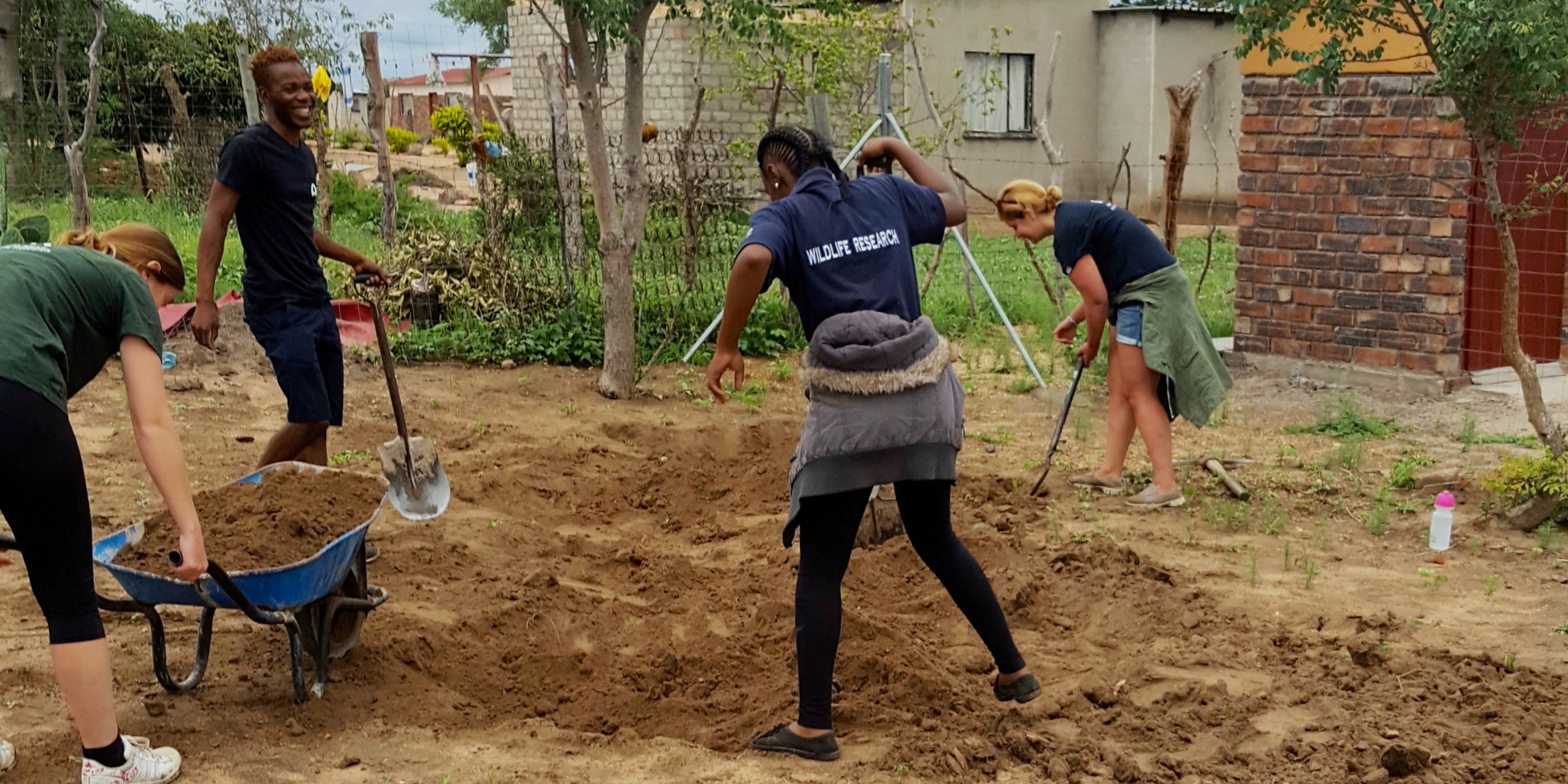 Why volunteer in Africa? You could help to improve educational facilities in Limpopo, South Africa. Pictured: GVI participants break ground on a construction project at a local creche.