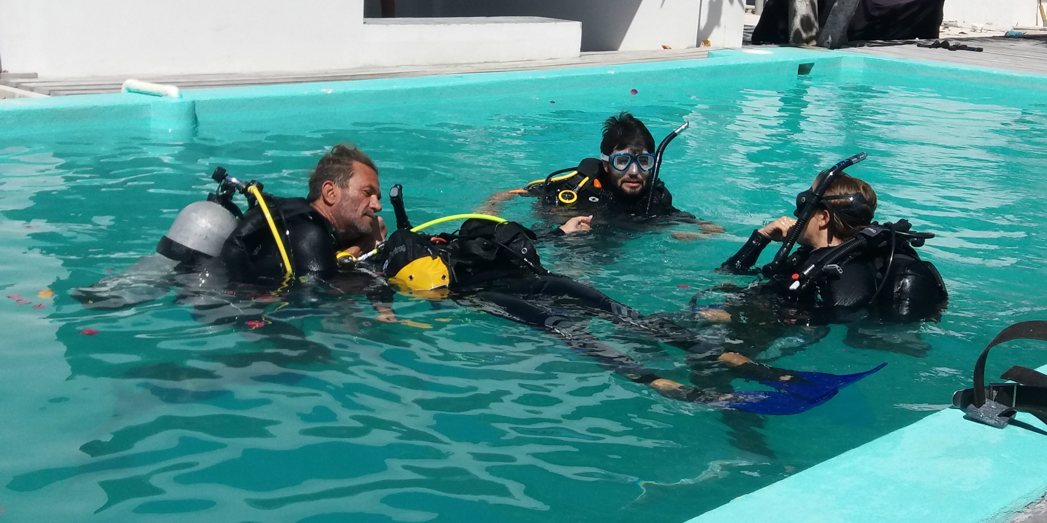 PADI pros train budding divers in a pool.