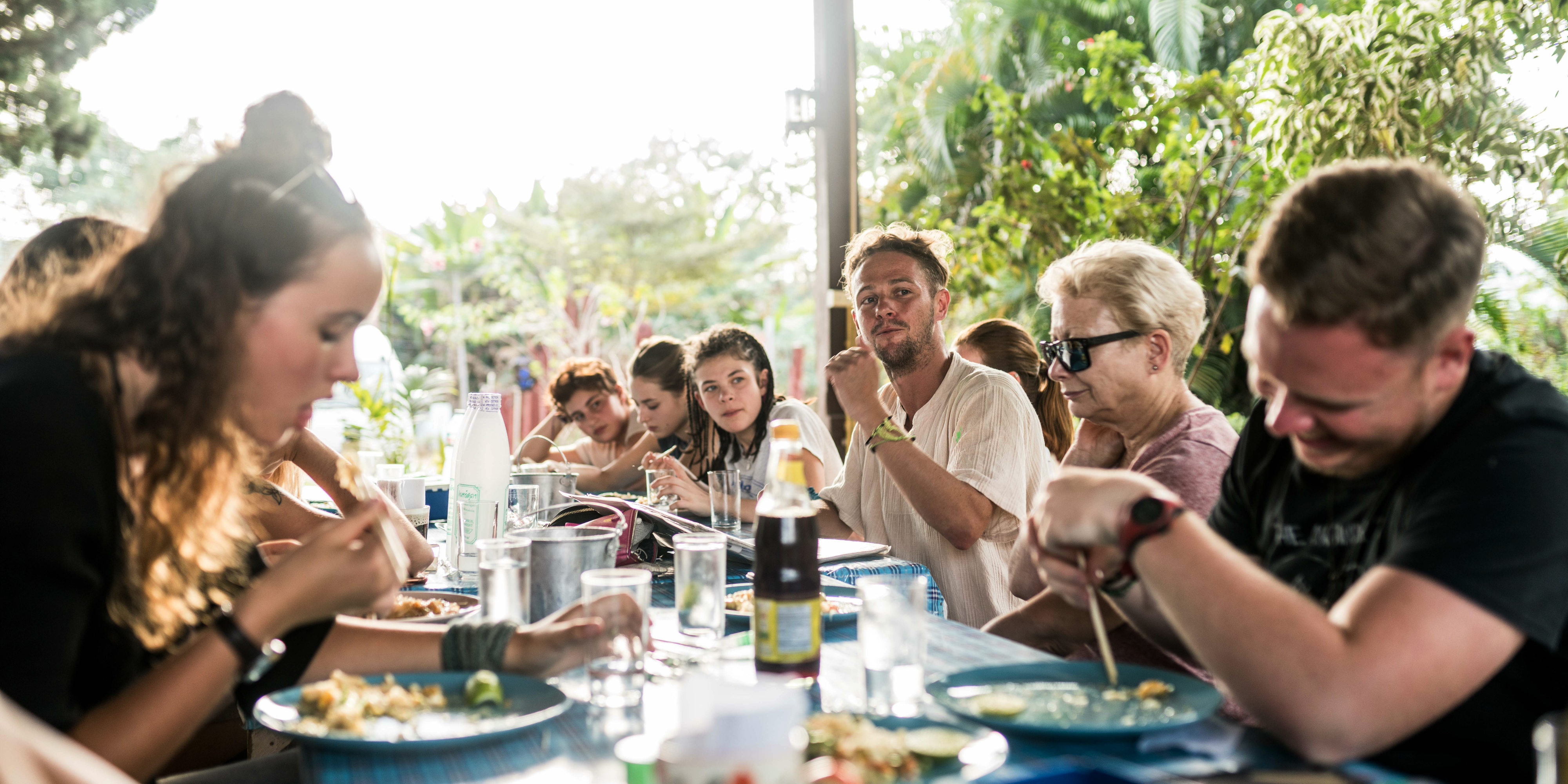 Taking a gap year as part of a program can be easier. Here, GVI participants in Chiang Mai share a group meal. Food and accomodation are taken care of in all GVI programs.
