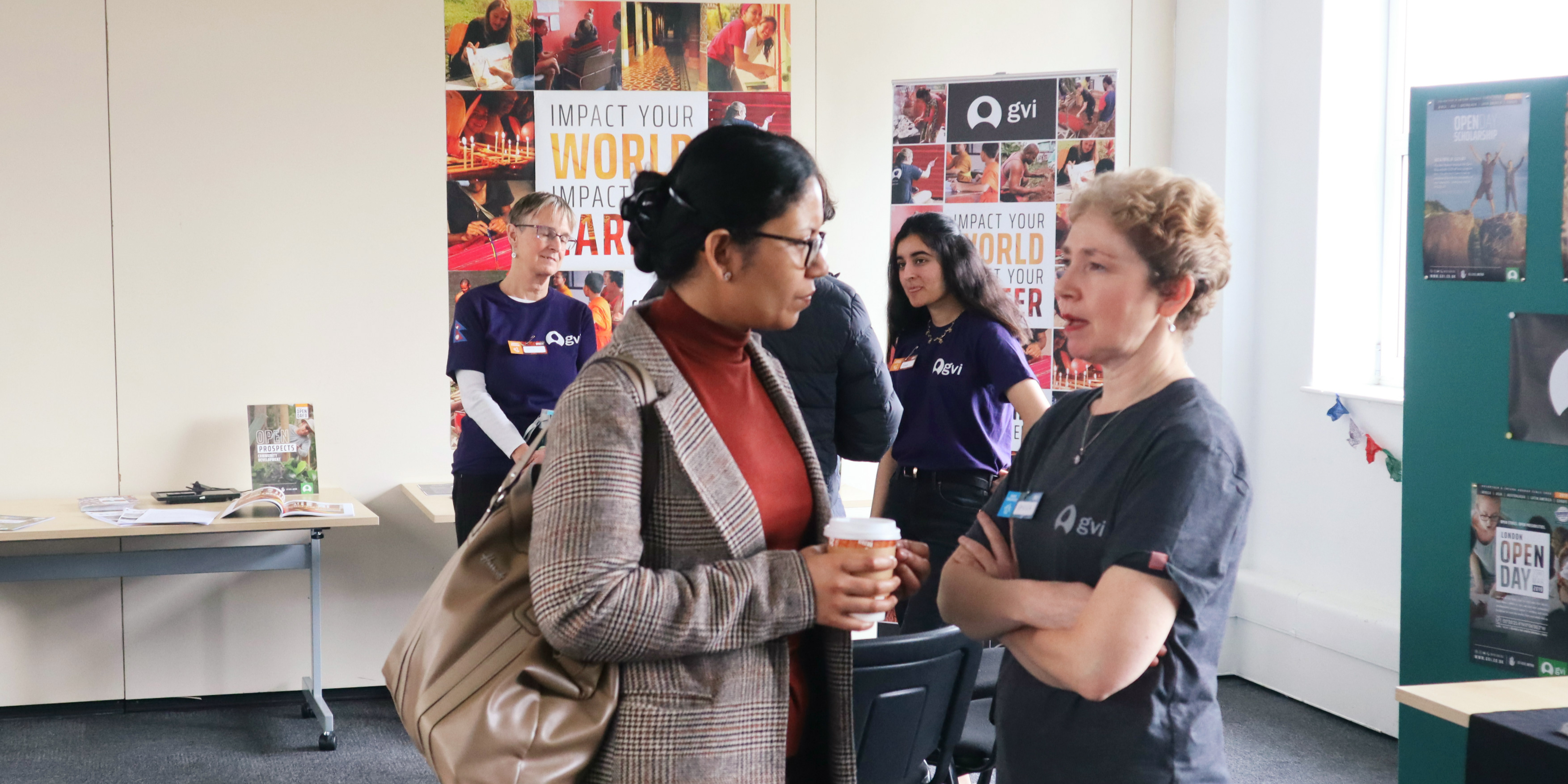 GVI ambassadors discuss GVI projects at an Open Day event in London. GVI's teen volunteering opportunities are a great way for teens to begin making an impact.