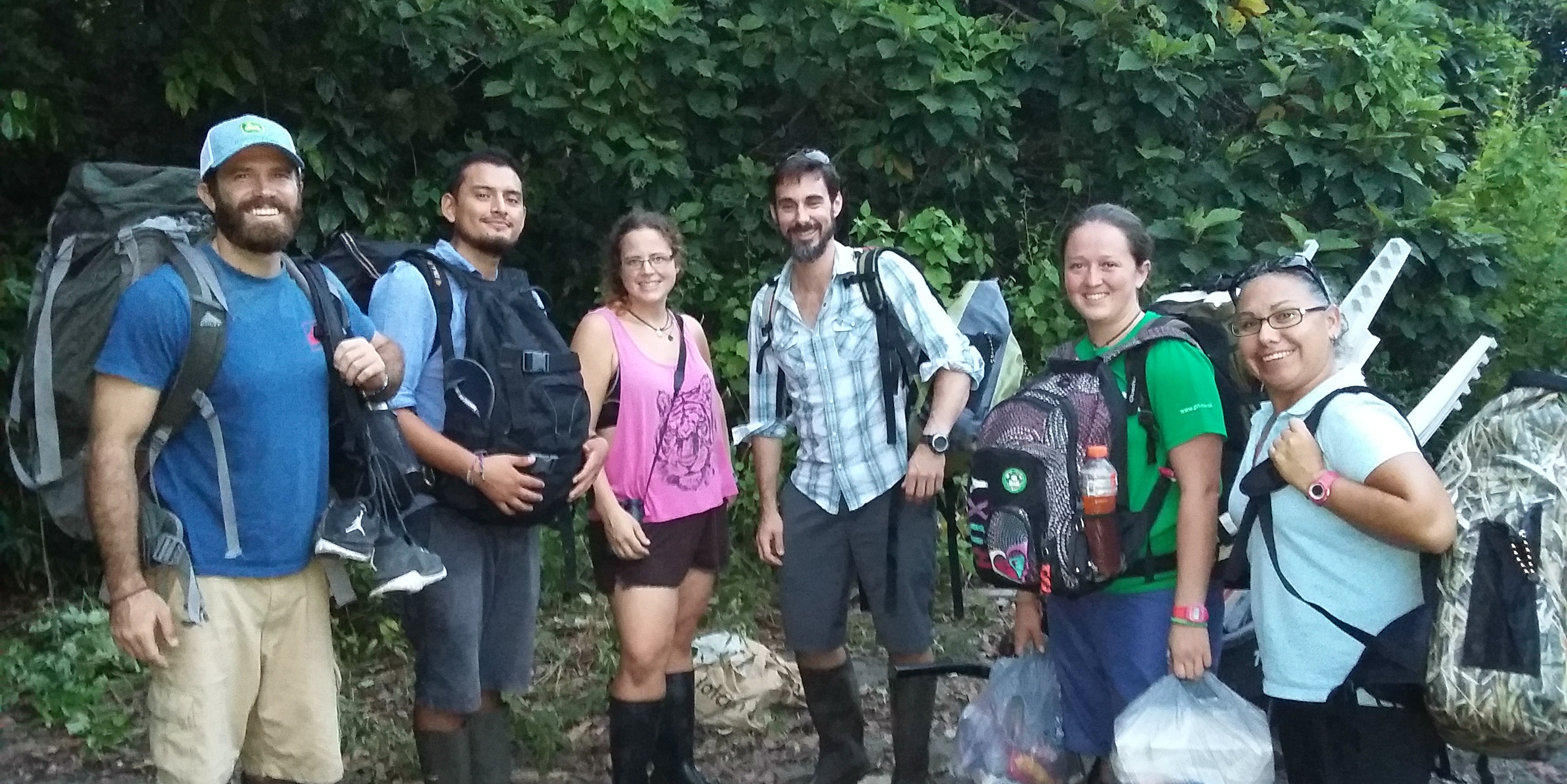 Participants prepare for to trek through the jungles of Jalova on a data collection trip. This science expedition makes our list of the best volunteer abroad programs for adults.