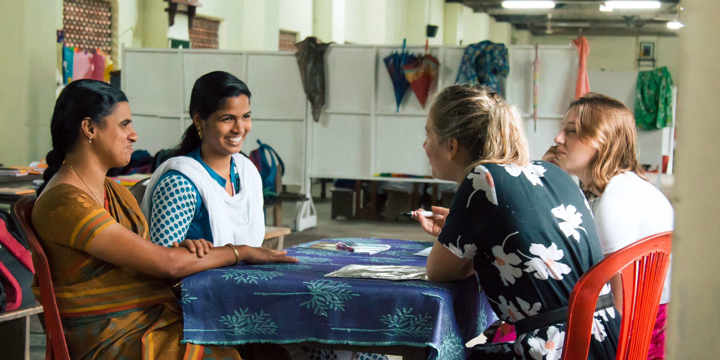 GVI participants engage with women in Kerala, India as part of womens empowerment programs. This is one of many career break ideas.