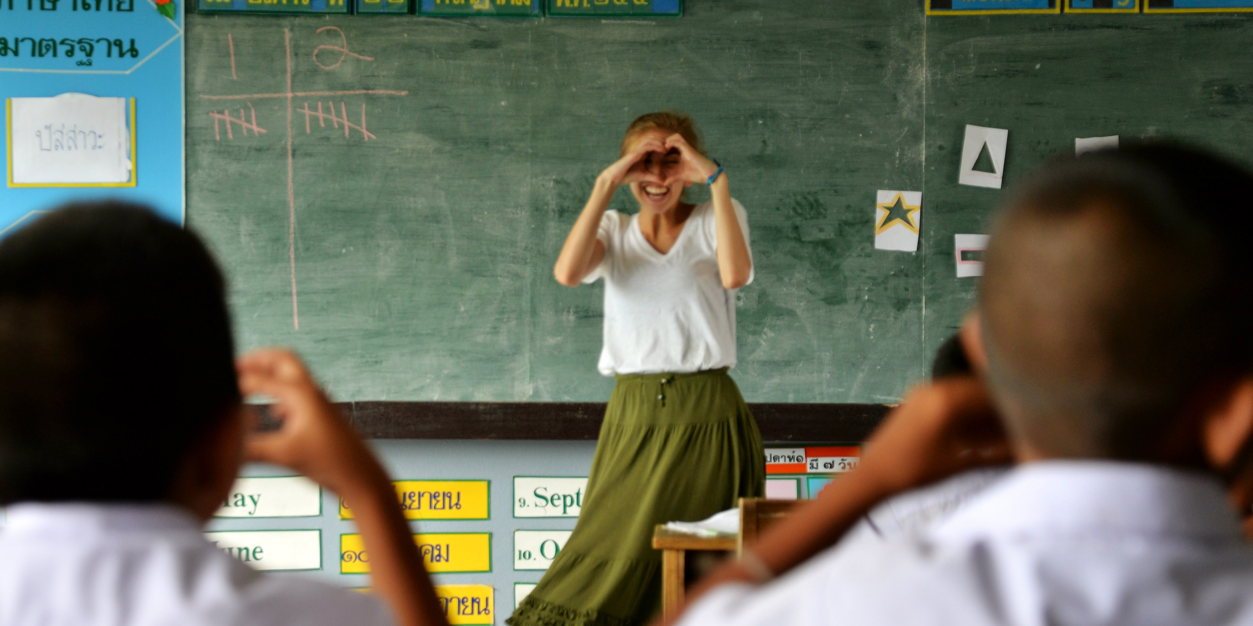 A teaching intern in Thailand teaches students about shapes   donate or volunteer