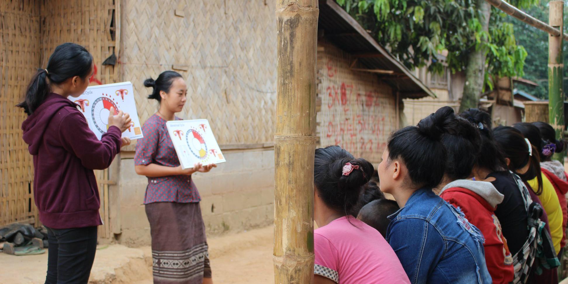 GVI community liasons lead a menstrual health workshop associated with a women's empowerment program.