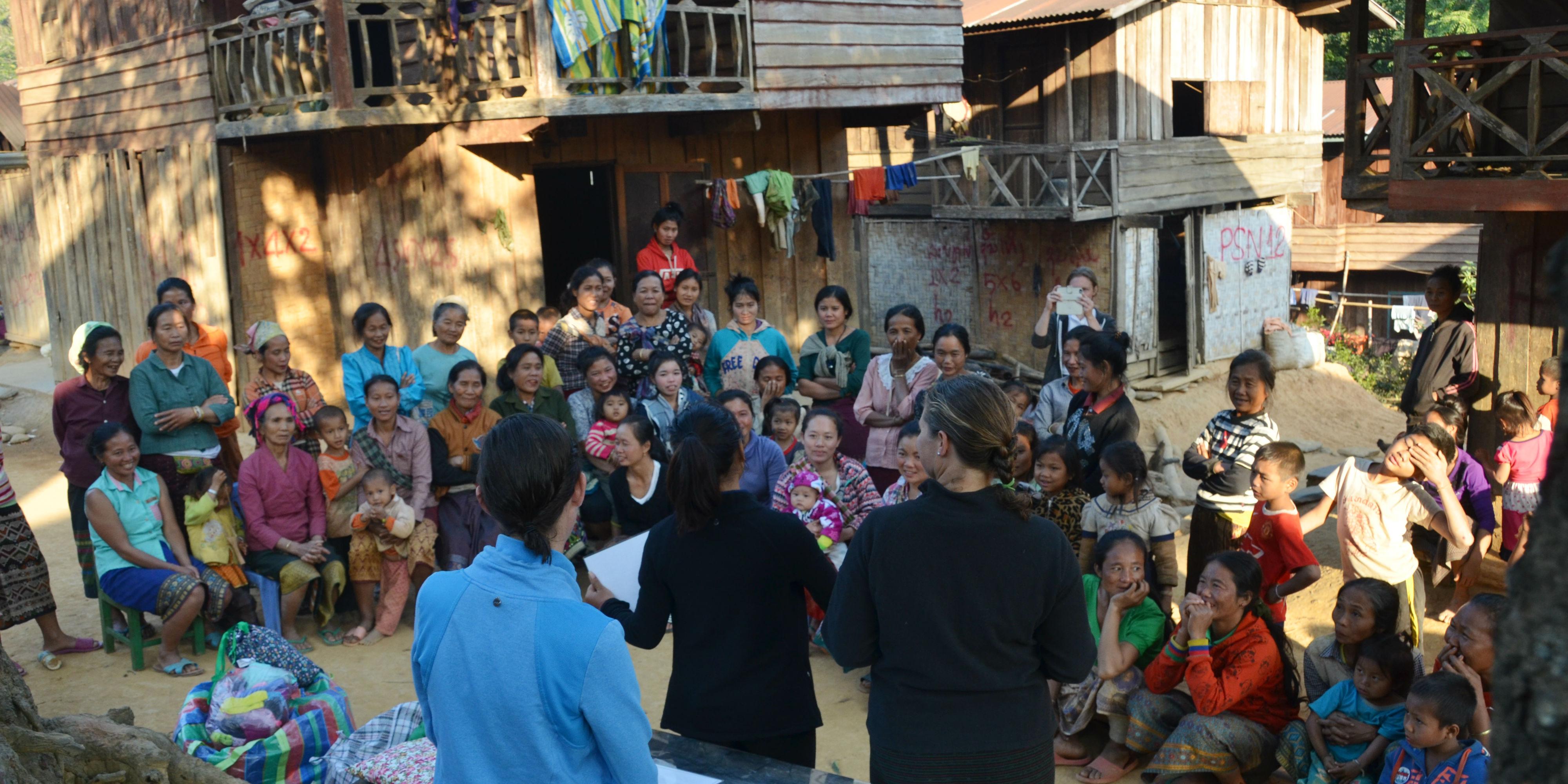 GVI participants help Laos women learn about menstration through a women's empowerment project.