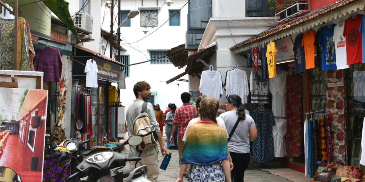 GVI participants walk through the streets of Kochi. When travelling to India with GVI, you should take out travel insurance.