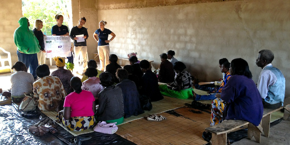 Pariticipants who volunteer in Zambia lead an education session.