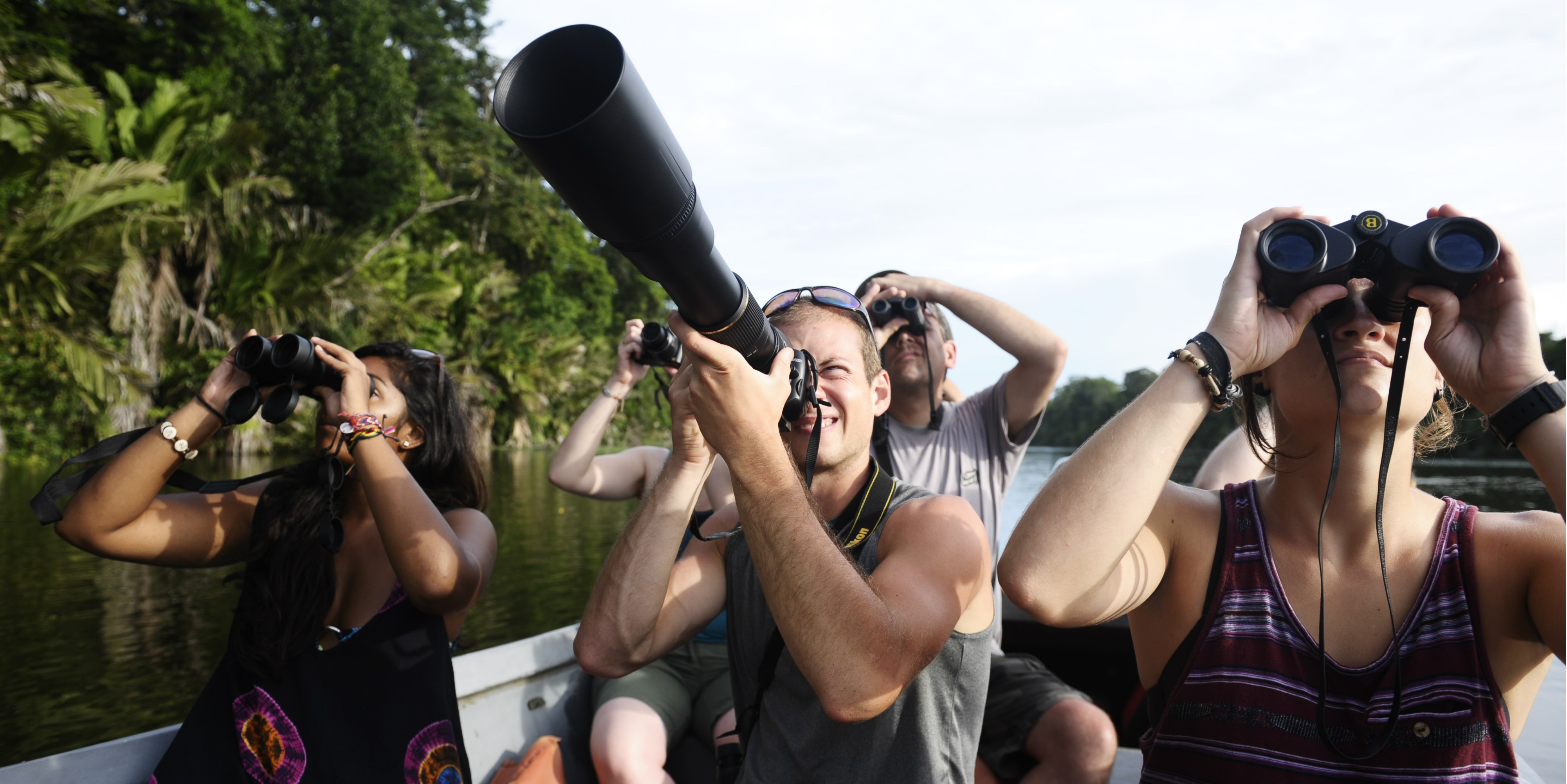Wildlife conservation volunteers take a boat ride in Jalova, and try to spot their favourite species.