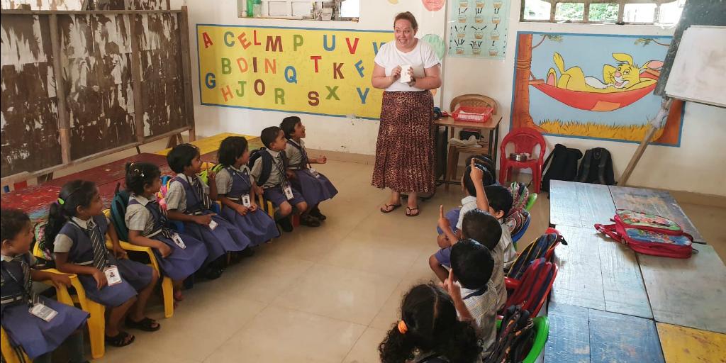 Volunteer teacher with students in Kerala