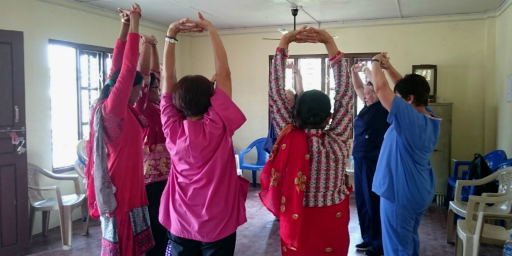 Nurses leading stretching exercises in Kerala