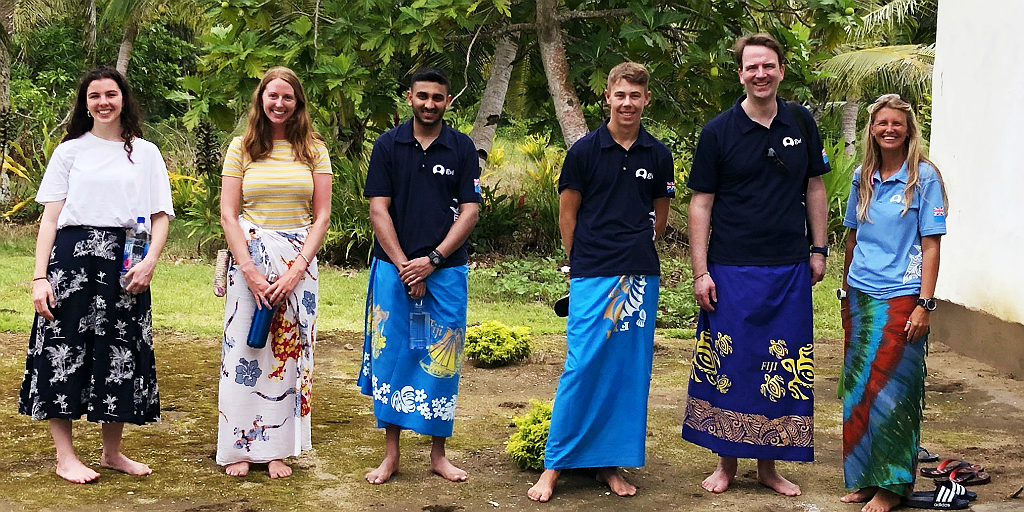 gvi volunteers immersed in caqalai culture wearing traditional attire