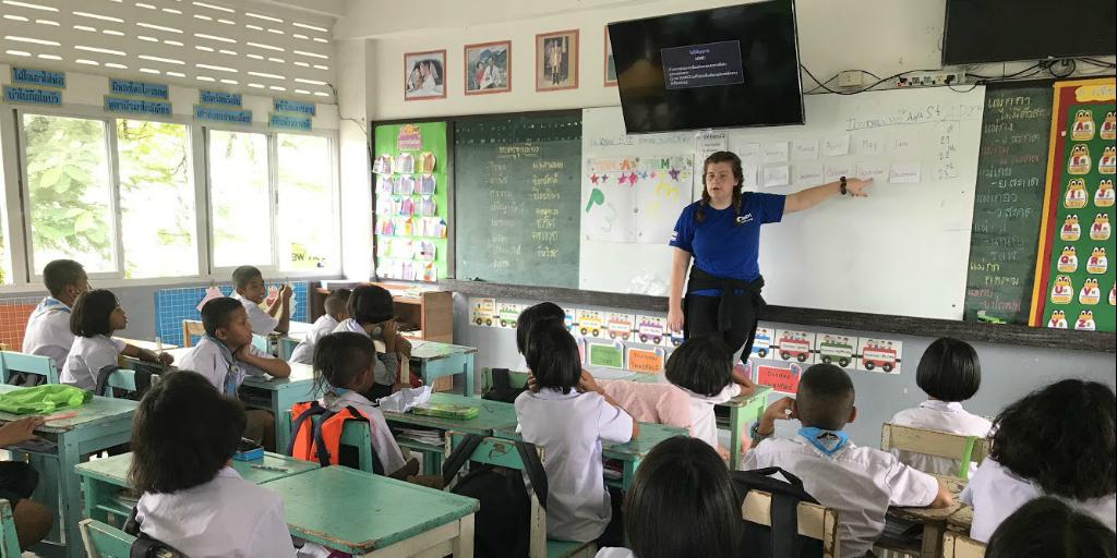 A volunteer teaching a class of children in Phang Nga, Thailand.