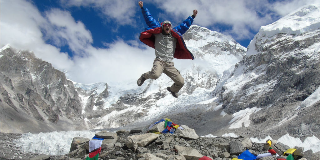 A volunteer jumping in the air at Everest base camp.