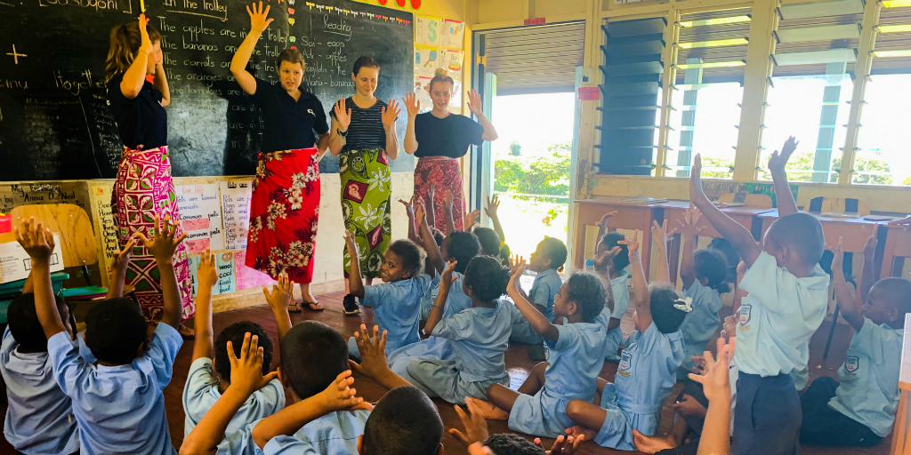 Volunteers teaching a class of children in Dawasmu.