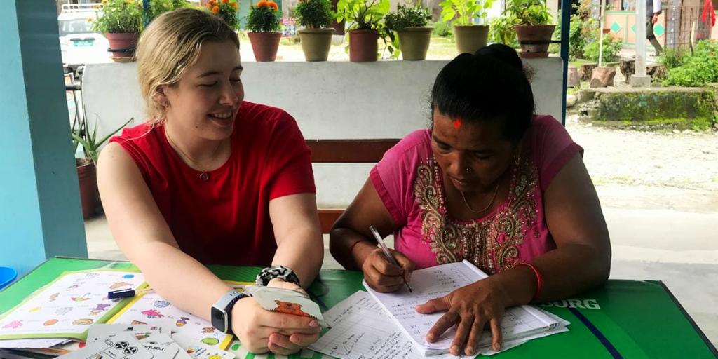 Volunteer teaching english while volunteering in Nepal.
