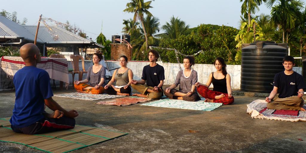 Try meditative yoga in Kochi India.